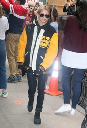Hailey Baldwin covered up in an oversized varsity jacket and leather pants for a day out in New York City.