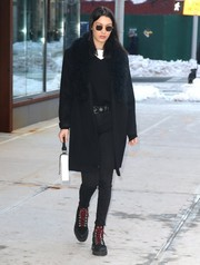 Bella Hadid completed her winter-chic ensemble with black hiking books by Off-White.