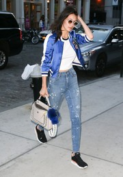 Bella Hadid completed her outfit with a taupe leather tote by Fendi.