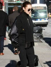 Bella Hadid rocked a pair of fingerless driving gloves while out in New York City.