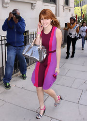 Bella carried this metallic bag with her vibrant fuchsia dress.