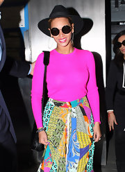 Beyonce teamed this hot pink top with a colorful maxi out in NYC.