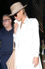 Beyonce Knowles accessorized with a beige Ugo Mozie fedora and a pair of oversized shades for a day out in New York City.