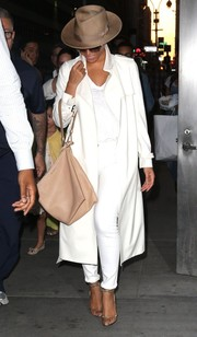 Beyonce Knowles cut a striking figure on the streets of NYC in her all-white Barneys New York trenchcoat, J Brand jeans, and T-shirt ensemble.