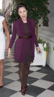 Ann Curry looked ultra-feminine at the Women in Music event in a purple ruffle cardigan layered over a dress and cinched with a stylish leather belt.