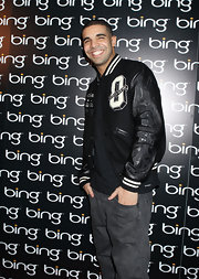 Drake rocked a leather Letterman's jacket at the launch of Bing Entertainment.