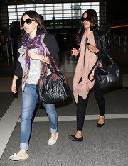 Freida Pinto wore a long pale pink scarf with a delicate print while arriving for a flight at LAX.
