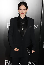 Winona Ryder matched the satin lapel of her tuxedo jacket to her classic black satin clutch.