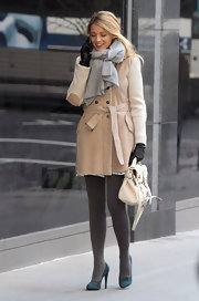 Blake Lively bundled up on the set of 'Gossip Girl' in a chic belted coat paired with teal suede pumps.
