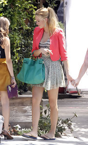 Blake Lively stepped on the 'Gossip Girl' set wearing a hot pink cropped jacket over a flirty ensemble.