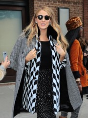 Blake Lively headed out in New York City wearing a pair of dark round glasses.