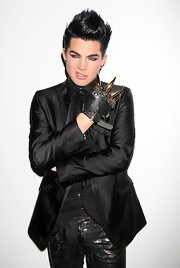 Ok Adam, we get it...you're edgy! The singer wore this wolverine-inspired black leather glove with gold spikes while sitting front row at The Blondes fashion show.