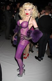 Amanda Lepore completed her look by wearing a pair of silver platforms.