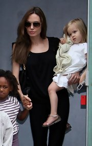 Vivienne Jolie Pitt's flat jelly sandal's were a stylish summer choice.