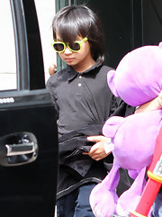 Maddox adds some flare with neon yellow wayfarer sunglasses.  Cool!