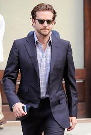 Bradley Cooper showed off his cool style in wayfarer sunglasses.