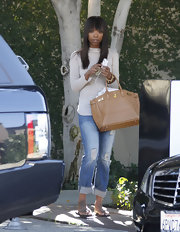Brandy kept her style ultra-luxe with a tan leather Birkin bag.