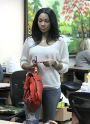 Bria Murphy looked easy-breezy in a white scoopneck sweater and ripped jeans when she had her nails done in Beverly Hills.