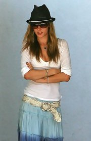 Bridgette Wilson topped off her boho-chic ensemble with a metallic silver woven belt.