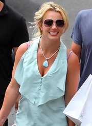 Britney Spears isn't one for to many accessories. She wore a simple gemstone necklace with a halter tank top.