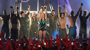 Britney Spears sparkled on stage in an emerald and black bodysuit.
