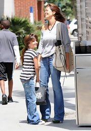 While out with her daughter Brooke Burke showed off her white leather shoulder bag.