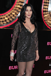 Layers of bangles added major glitter to Cher's look during the 'Burlesque' Los Angeles premiere.