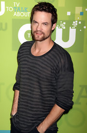 Shane West looked subdued but still sexy in a striped gray-and-black crewneck sweater.