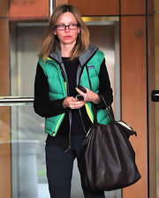 Calista Flockhart ran errands carrying a brown leather tote with braided detailing.