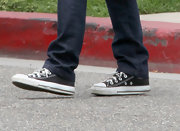 Calista Flockhart opted for super casual black canvas sneakers for her daytime look while out in California.