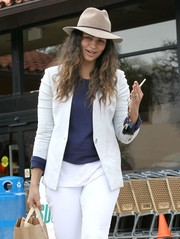 Camila Alves tried to keep a low profile with a beige fedora while out shopping.