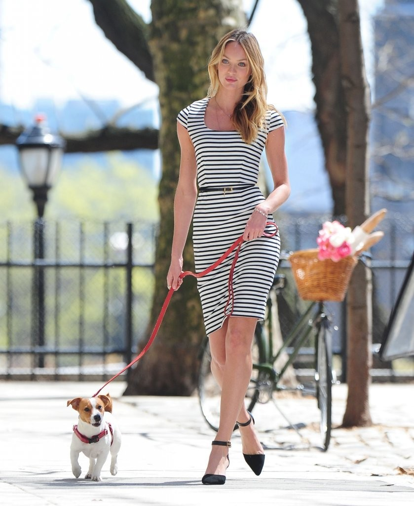Victoria's Secret model Candice Swanepoel poses for a fashion photo shoot with a dog on April 25, 2013 in New York City, New York.