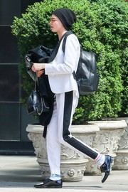 Cara Delevingne matched her big backpack with a smaller one by Chanel.