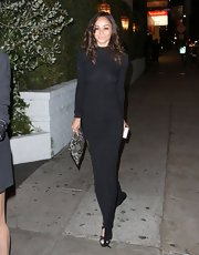 Cara Santana chose a solid black, long-sleeved maxi for her evening look while going out in Hollywood.