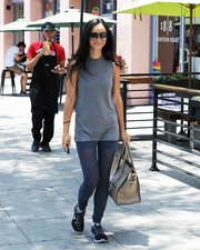 Semi-sheer blue leggings added a hint of sexiness to Cara Santana's look.