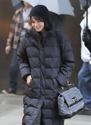 Carey Mulligan's ladylike top handle Miss Sicily tote stood in stark contrast to her casual black down coat.