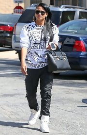 Cassie showed off her hip-hop style with this white 'Homies' sweatshirt.