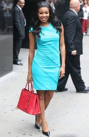Gabrielle Union went for a fun color-block look with this red Prada tote and turquoise dress combo.