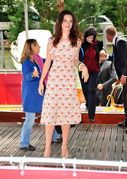 Rebecca dons a sweet and summery print dress in Venice with her cast mates.