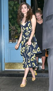 Emmy Rossum completed her ensemble with a black croc-embossed box clutch by Edie Parker.