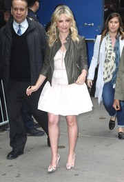 Sarah Michelle Gellar toned down the sweetness with a charcoal leather jacket, also by Rebecca Taylor.