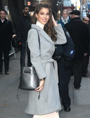 Miss Universe Iris Mittenaere was spotted outside the 'Good Morning America' studio sporting a silver shoulder bag and gray coat combo.