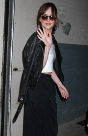 Dakota Johnson headed to the AOL Build event wearing a pair of red-lens sunglasses.