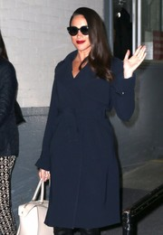 Meghan Markle headed out in New York City wearing classic cateye sunglasses.