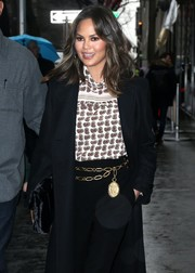 Chrissy Teigen jazzed up her ensemble with a gold chain belt by Chanel.