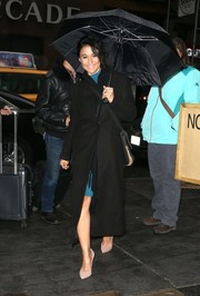 Emmanuelle Chriqui geared up for cold New York weather in a classic black wool coat.