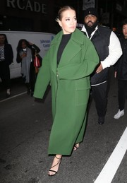 Rita Ora headed to 'The Today Show' rocking an oversized green wool coat by Emilio Pucci.