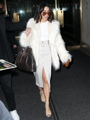 Underneath her coat, Vanessa Hudgens was chic in a By Johnny zip-front pencil skirt.