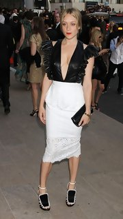Chloe Sevigny matched her black-and-white CFDA Awards look with a black patent leather envelope clutch.