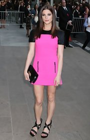 Ashley Greene accessorized her black and hot pink frock with a black patent envelope clutch.